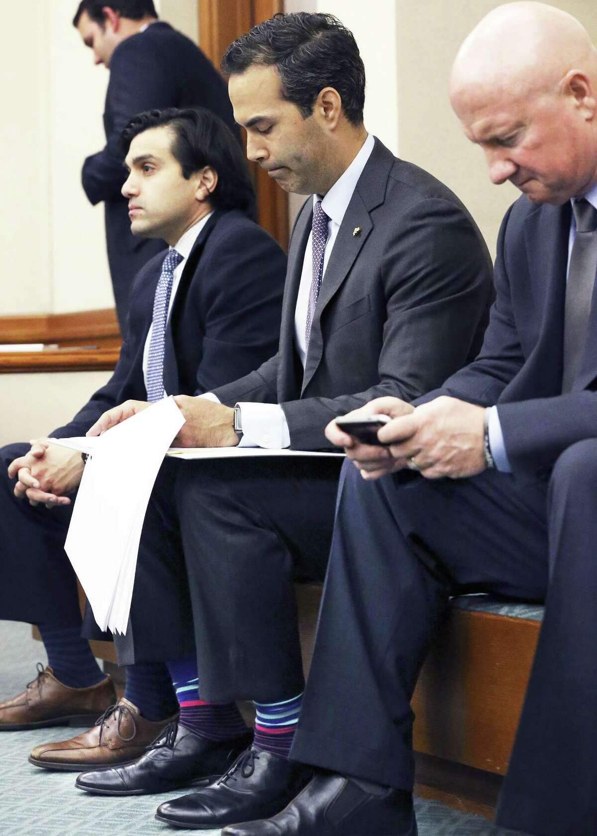 Texas Land Commissioner George P. Bush studies his notes before taking the floor as the Senate Finance Committee hears presentations at the Capitol on February 9, 2017.