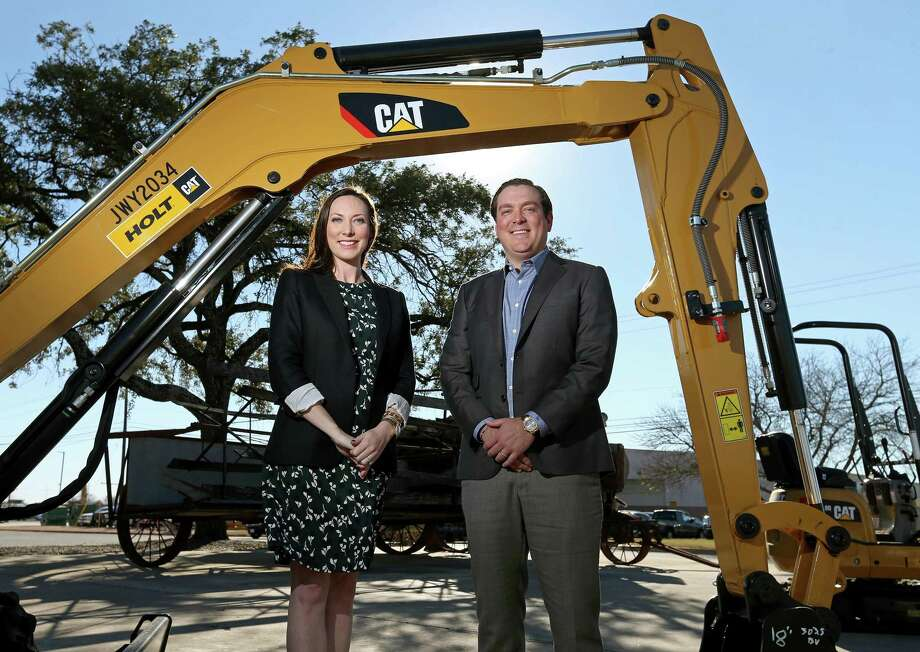 Corinna Holt Richter (left), Holt Cat's chief administrative officer, and her brother, Peter John Holt, general manager, in front of Holt Cat's headquarters in San Antonio. The siblings will take control of Holt Cat next year from their father, Peter M. Holt. Photo: Edward A. Ornelas /San Antonio Express-News / © 2017 San Antonio Express-News