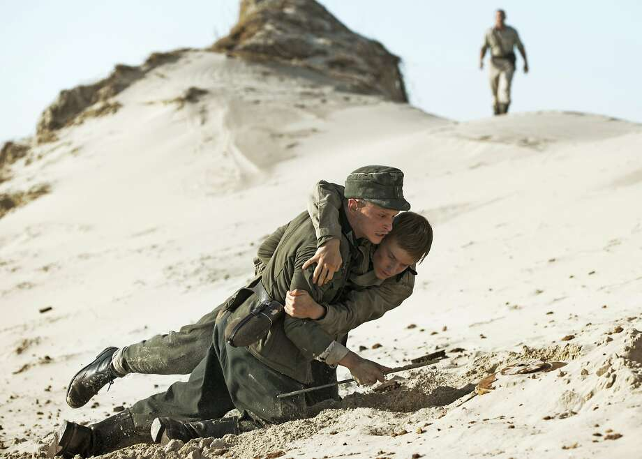"""German POWs Helmut (Joel Basman, front) and Sebastian (Louis Hoffman) try to survive in Oscar nominee """"Land of Mine."""" Photo: Sony Pictures Classics"""