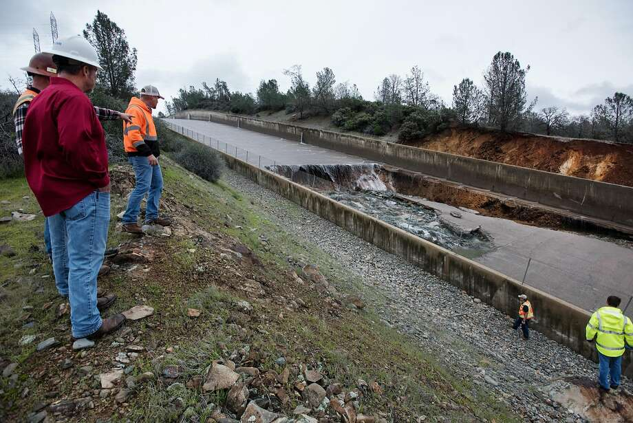 The California Department of Water Resources has suspended flows from the Oroville Dam spillway after a concrete section eroded on the middle section of the spillway.  Photo: Kelly M. Grow, California Department Of Water Resources
