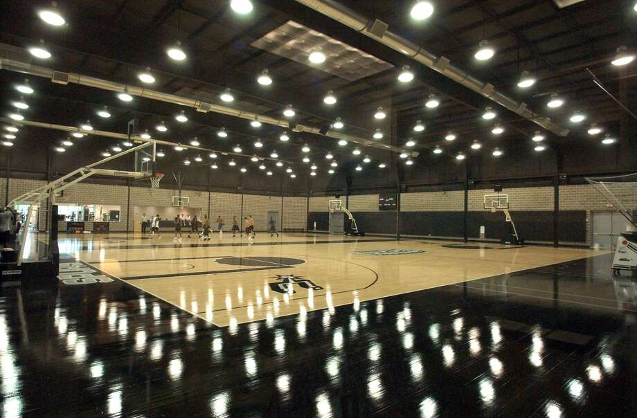 The Spurs' practice courts at their facility located in San Antonio's Medical Center area is shown at its opening in 2002. Photo: Express-News File Photo / SAN ANTONIO EXPRESS-NEWS