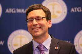Washington Attorney General Bob Ferguson reacts during a press conference about a San Francisco appeals court's decision touphold a temporary restraining order halting President Trump's immigration ban.   The dispute centered on a lawsuit filed Jan. 30 by Ferguson. Attorneys for the state won a temporary pause on Trump's executive order blocking entry to the U.S. by refugees worldwide and certain immigrants from seven Muslim majority nations.