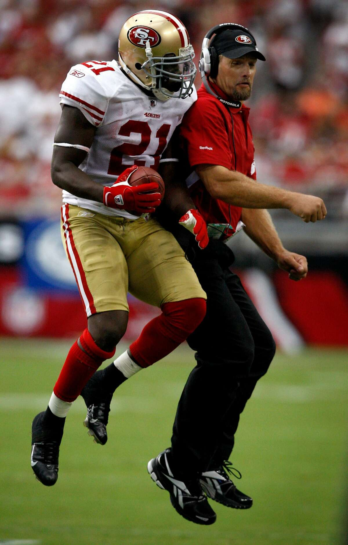 Frank Gore bumps with running backs coach Tom Rathman while they celebrate Gore's touchdown in the second quarter of the San Francisco 49ers vs. Arizona Cardinals NFL game in Glendale, Ariz., on Sunday, Sept. 13, 2009.
