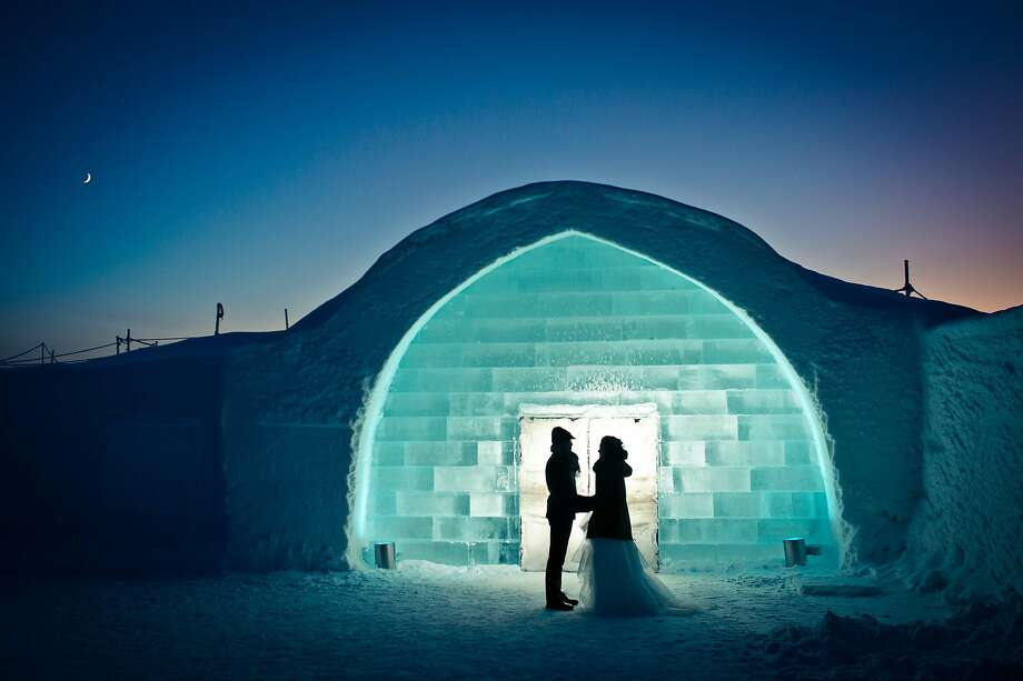 A couple exchanges vows outside an igloo at the Icehotel in Sweden. Photo: Asaf Kliger / IceHotel