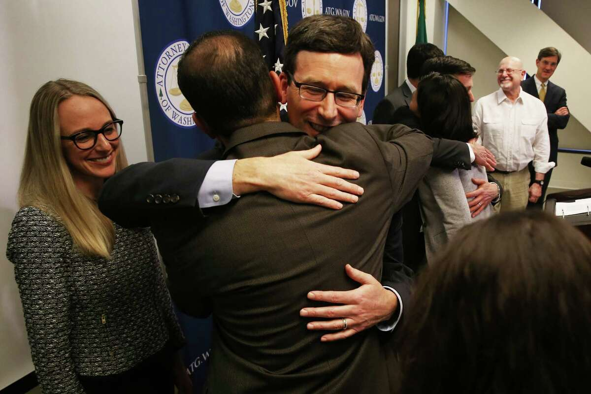 Washington State Attorney General Bob Ferguson hugs legal team member Patricio Marquez after the U.S. 9th Circuit Court of Appeals refused to remove a Seattle judge's restraining order on the travel ban Ferguson and his team fought against.