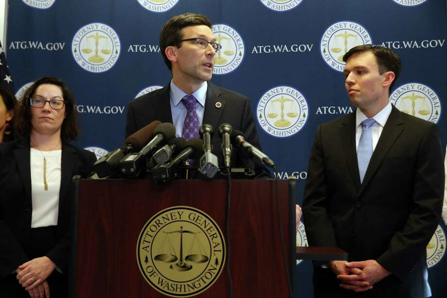 The state's legal team fighting President Trump's travel ban: Attorney General Bob Ferguson is flanked by Solicitor General Noah Purcell, right, and Civil Rights Unit chief Colleen Melody. Photo: GENNA MARTIN, SEATTLEPI.COM / SEATTLEPI.COM