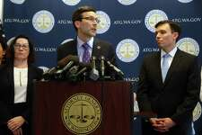 """Flanked by Solicitor General Noah Purcell, right, and Civil Rights Unit chief Colleen Melody, left, Washington State Attorney General Bob Ferguson speaks after the U.S. Ninth Circuit Court of Appeals left in place a restraining order against immigration restrictions targeting Muslim-majority countries put forward by President Trump. Ferguson sued to block the implementation of Trump's executive order, widely described as a """"Muslim ban."""