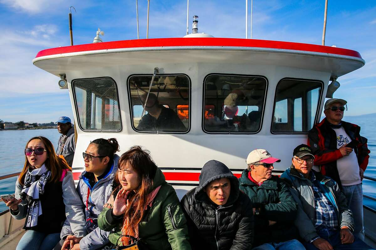 Passengers relax near the end of a fishing and crabbing trip with Randy's Fishing in Monterey, California, on Monday, Jan. 30, 2017.