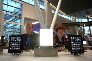 Doug and Kay Wilson, of Houston, try out the new iPads inside the almost-completed Terminal C North at George Bush Intercontinental Airport during a sneak peek event Thursday evening, Feb. 9, 2017, in Houston. ( Mark Mulligan / Houston Chronicle )