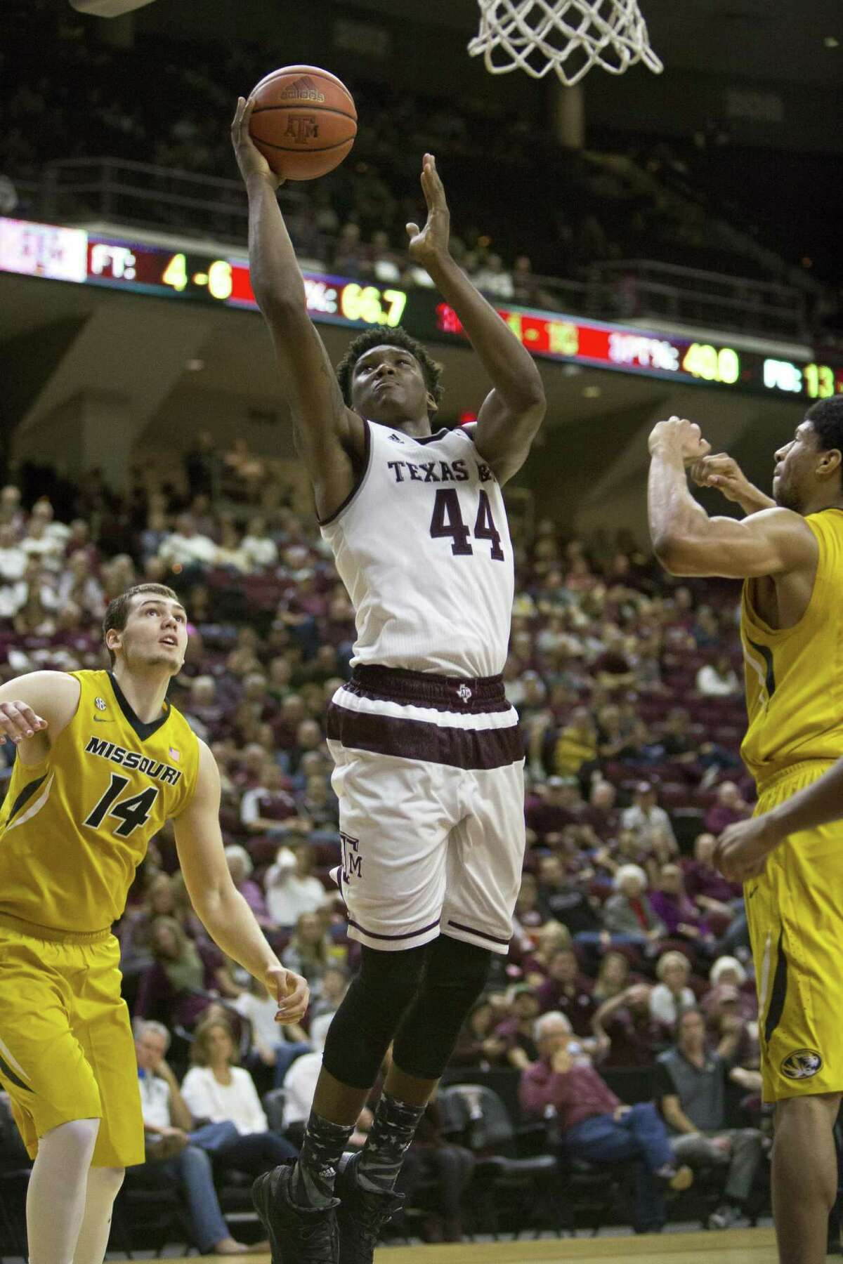 Texas A&M freshman forward Robert Williams (44) puts a shot up past Missouri defenders on Feb. 8, 2017, in College Station.