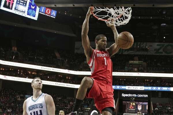 Houston Rockets' Trevor Ariza (1) dunks past Charlotte Hornets' Frank Kaminsky III (44) during the first half of an NBA basketball game in Charlotte, N.C., Thursday, Feb. 9, 2017. (AP Photo/Chuck Burton)