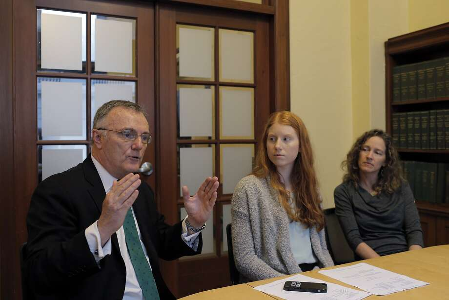 Tia Hatton, 19, center, an Oregon college student with her attorney Julia Olson, right, and Philip Gregory, left, at the Commonwealth Club in San Francisco, Calif., on Thursday, February 9, 2017. Hatton is one of 21 youths suing President Trump for failing to do anything about climate change, and the suit has been going on for years and looks like it may come to trial in Oregon later this year.  The kids, backed by public interest lawyers, are maintaining that failing to protect the earth harms their futures, and that young people have the most to lose. Photo: Carlos Avila Gonzalez, The Chronicle