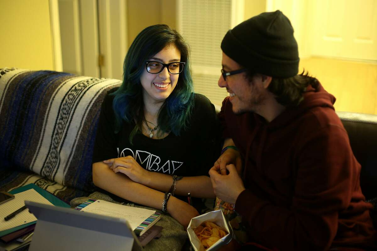 """Iris and her boyfriend Chris met on """"High There!,"""" a social network for cannabis enthusiasts."""