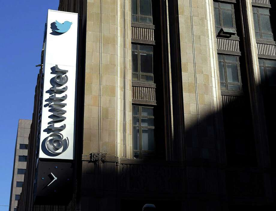 FILE - This Nov. 4, 2013, file photo shows the sign outside of Twitter headquarters in San Francisco. Twitter announced Thursday, Feb. 9, 2017, that the company is struggling to convert its headline omnipresence into cash and its profit expectations going forward is sending investors scattering. (AP Photo/Jeff Chiu, File) Photo: Jeff Chiu, STF / Copyright 2016 The Associated Press. All rights reserved. This material may not be published, broadcast, rewritten or redistribu
