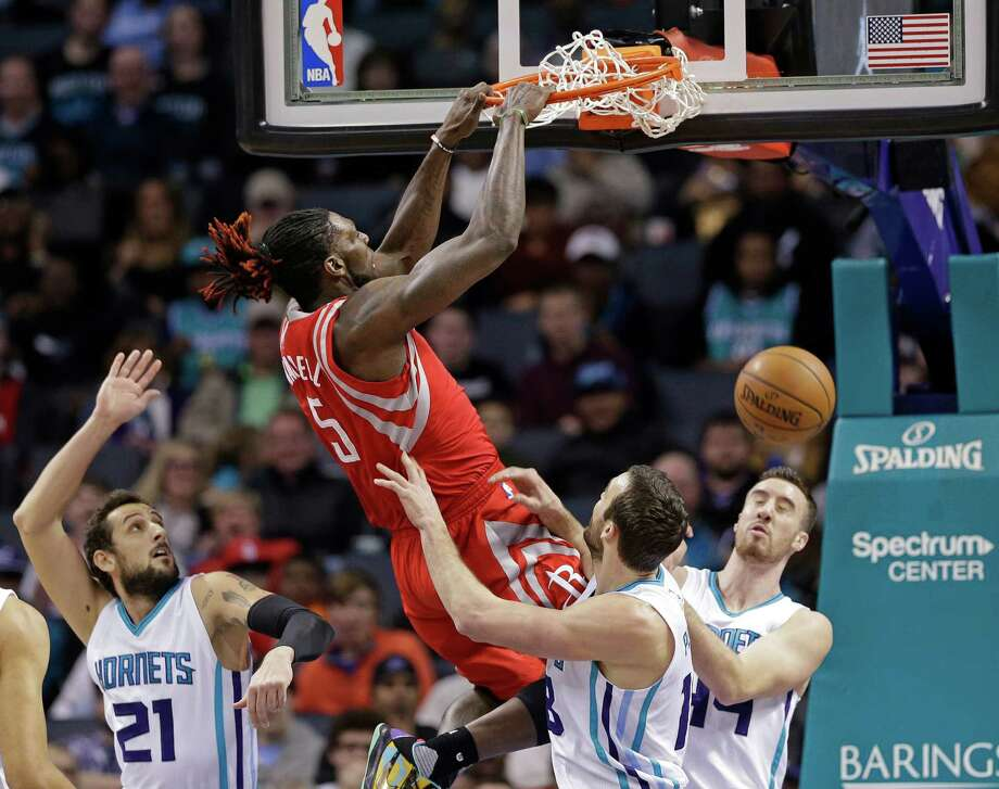 Houston Rockets' Montrezl Harrell (5) dunks against Charlotte Hornets' Frank Kaminsky III (44), Marco Belinelli (21) and Miles Plumlee (18) during the first half of an NBA basketball game in Charlotte, N.C., Thursday, Feb. 9, 2017. (AP Photo/Chuck Burton) Photo: Chuck Burton, STF / Copyright 2017 The Associated Press. All rights reserved.