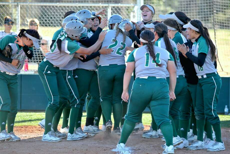 The Midland College softball team celebrates at home plate after Kayla Shaw (22) hit a grand slam against Trinidad State Junior College on Thursday afternoon at the Midland College softball field. Photo by Forrest Allen/Midland College Athletics