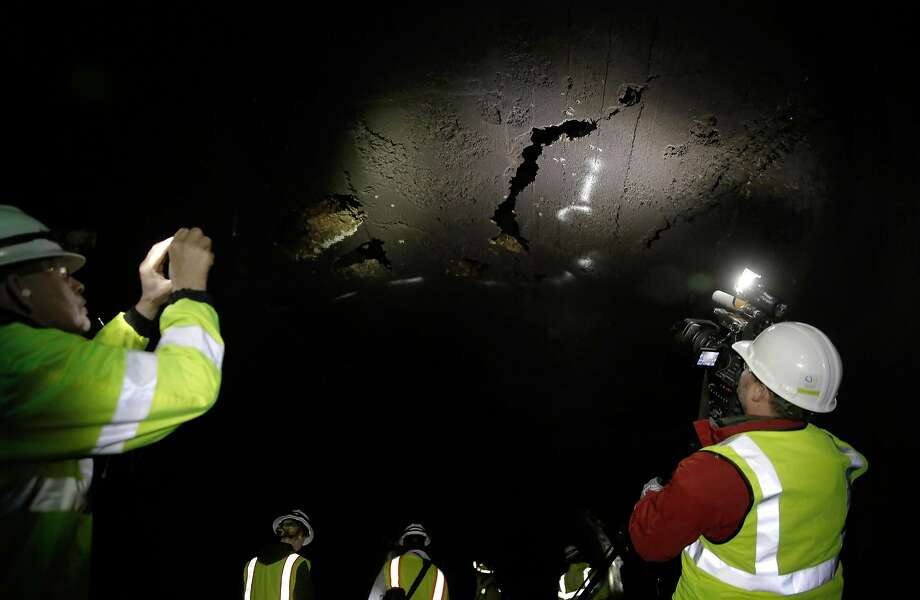 A media tour stops to observe the repair sites inside Mountain Tunnel,  which transports water from the Hetch Hetchy Reservoir  near Groveland, Ca., as seen on Wednesday Feb. 8, 2017, as the city of San Francisco continues to repair and inspect the tunnel. Photo: Michael Macor, The Chronicle