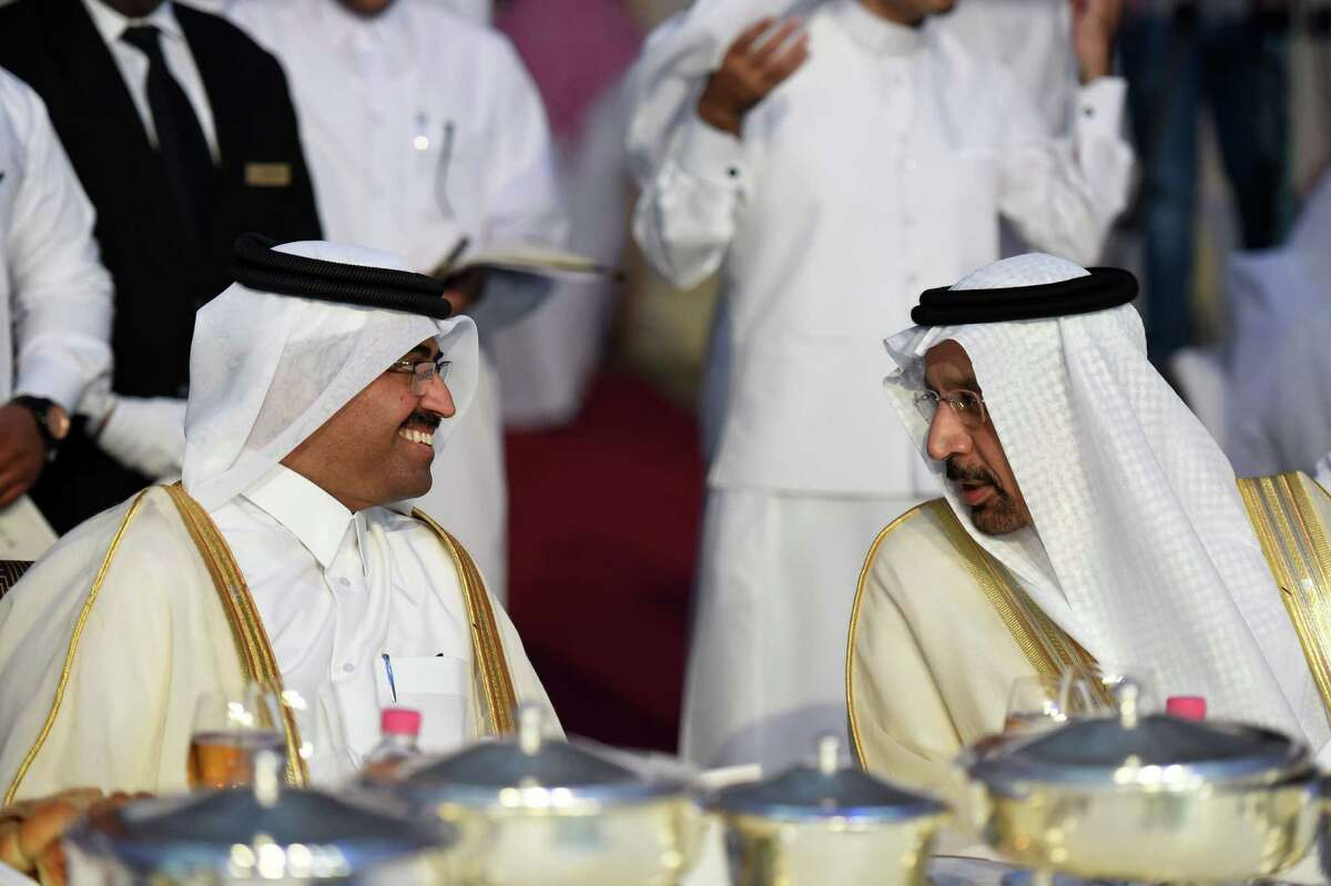 Saudi Minister of Energy Khalid al-Falih, right, talks with Qatar's energy minister, Mohammed bin Saleh al-Sada, during an economic forum last fall. Bin Saleh al-Sada is also president of OPEC.