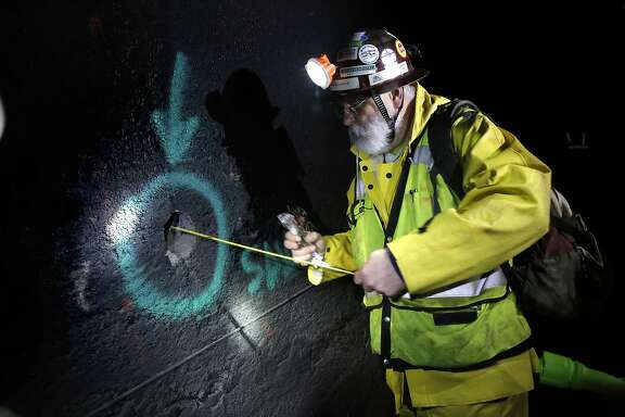 The project engineer and designer Glenn Boyce measures the depth of the tunnel wall through a drilled core sample hole inside Mountain Tunnel, which transports water from the Hetch Hetchy Reservoir near Groveland, Ca., as seen on Wednesday Feb. 8, 2017. The city of San Francisco continues to repair the infrastructure of Mountain Tunnel.l