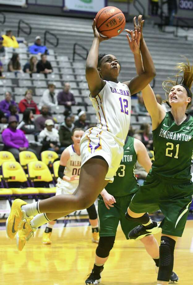 University at Albany's Imani Tate drives to the basket during a basketball game against Binghamton at SEFCU Arena on Thursday, Feb. 9, 2017 in Albany, N.Y. (Lori Van Buren / Times Union) Photo: Lori Van Buren / 20039653A