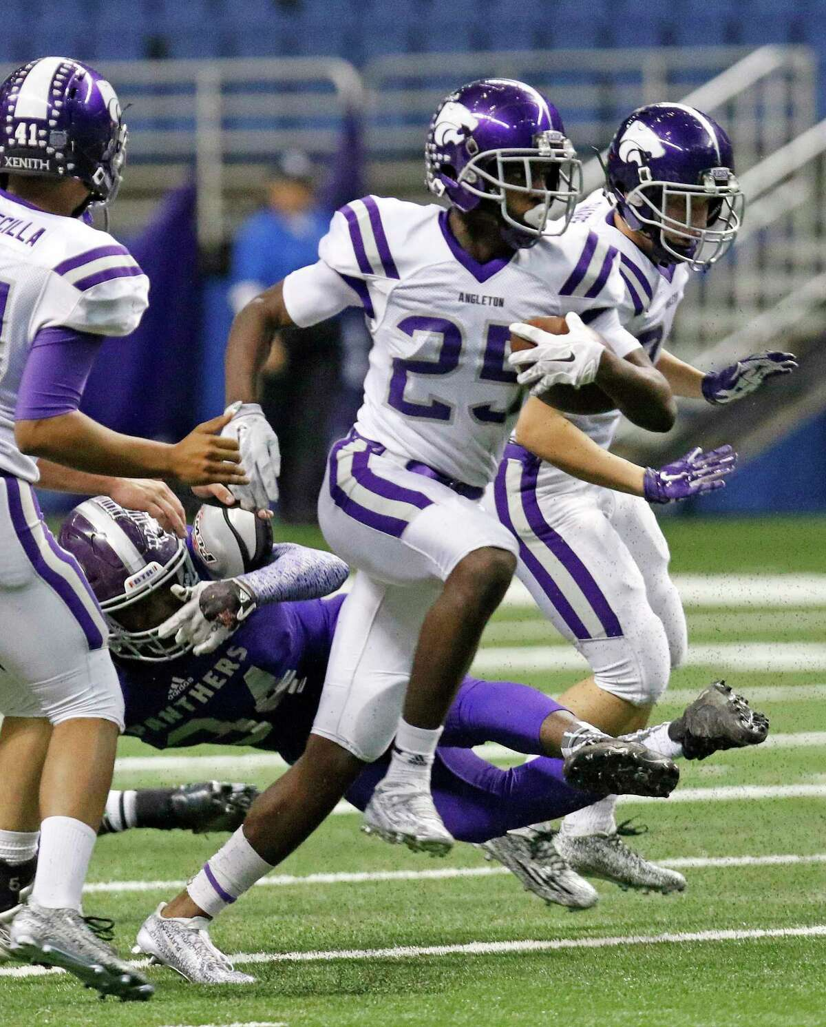 Angleton's B.J. Foster, here running for yardage in the state playoffs, likely will be converted into a safety at UT.