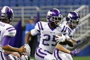 Angle ton's Billy Foster runs for sizable yardage in first half. 548520 HSFB Ridgepoint vs Angleton in the Class 5A Division II state quarterfinals at Alamodome on Saturday, Dec. 5, 2015.