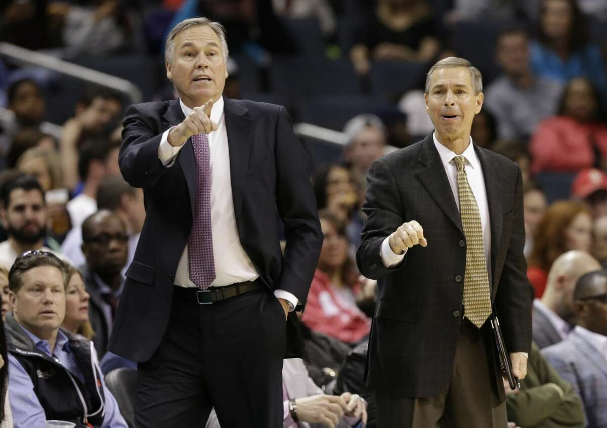 Houston Rockets head coach Mike D'Antoni, left, and assistant Jeff Bzdelik, right, direct their team against the Charlotte Hornets in the first half of an NBA basketball game in Charlotte, N.C., Thursday, Feb. 9, 2017. (AP Photo/Chuck Burton)