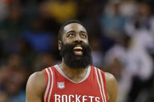 Houston Rockets' James Harden (13) smiles as he walks up the court in the first half of an NBA basketball game against the Charlotte Hornets in Charlotte, N.C., Thursday, Feb. 9, 2017. (AP Photo/Chuck Burton)