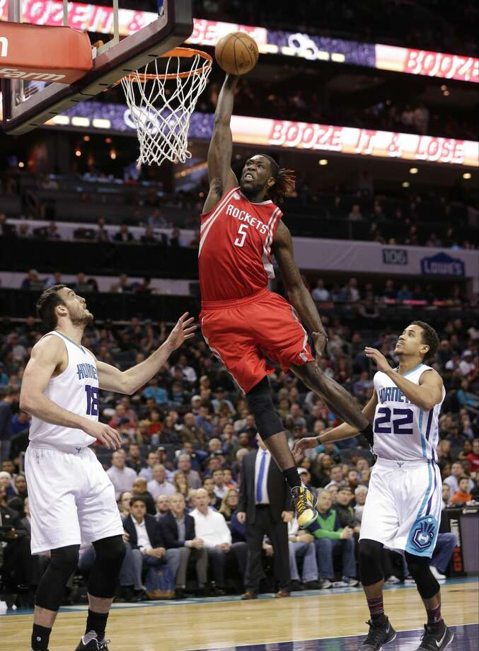 Houston Rockets' Montrezl Harrell (5) dunks against Charlotte Hornets' Miles Plumlee (18) and Brian Roberts (22) in the second half of an NBA basketball game in Charlotte, N.C., Thursday, Feb. 9, 2017. The Rockets won 107-95. (AP Photo/Chuck Burton) Photo: Chuck Burton/Associated Press