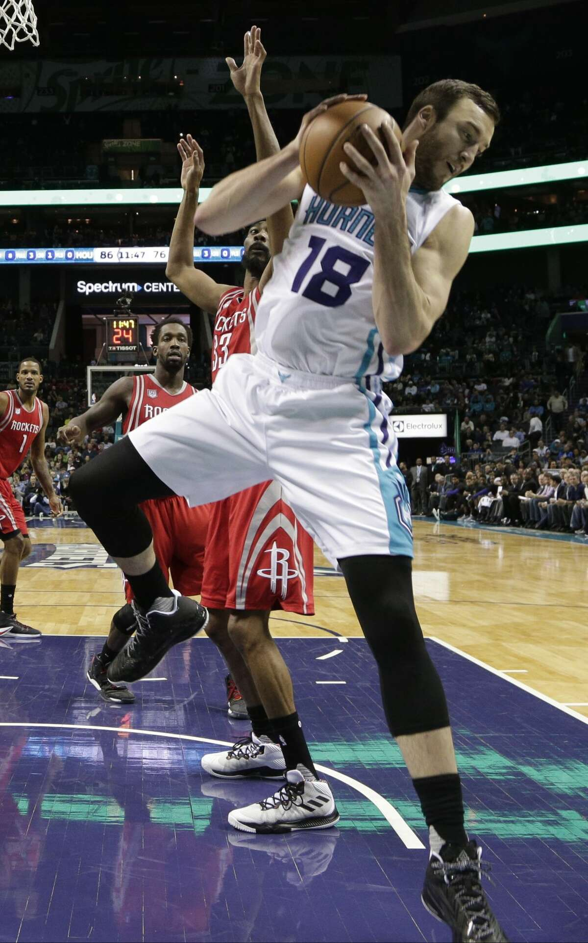Charlotte Hornets' Miles Plumlee (18) grabs a rebound against the Houston Rockets in the second half of an NBA basketball game in Charlotte, N.C., Thursday, Feb. 9, 2017. The Rockets won 107-95. (AP Photo/Chuck Burton)