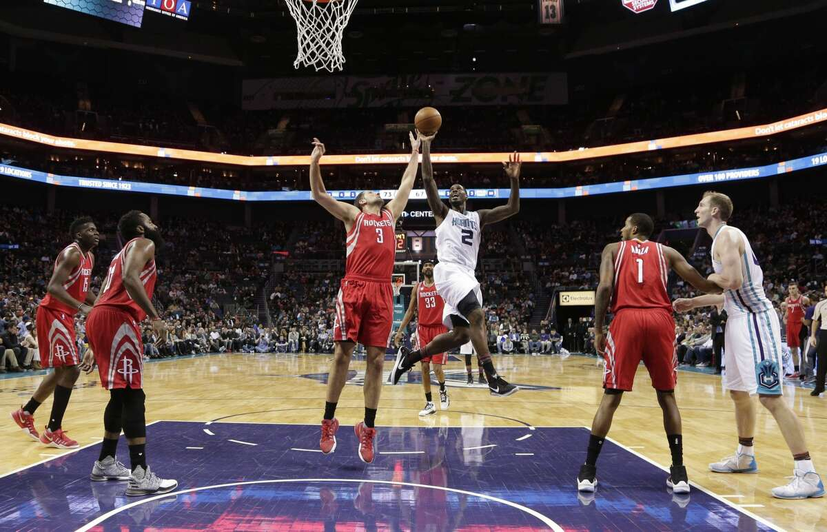 Charlotte Hornets' Marvin Williams (2) shoots over Houston Rockets' Ryan Anderson (3) in the second half of an NBA basketball game in Charlotte, N.C., Thursday, Feb. 9, 2017. The Rockets won 107-95. (AP Photo/Chuck Burton)