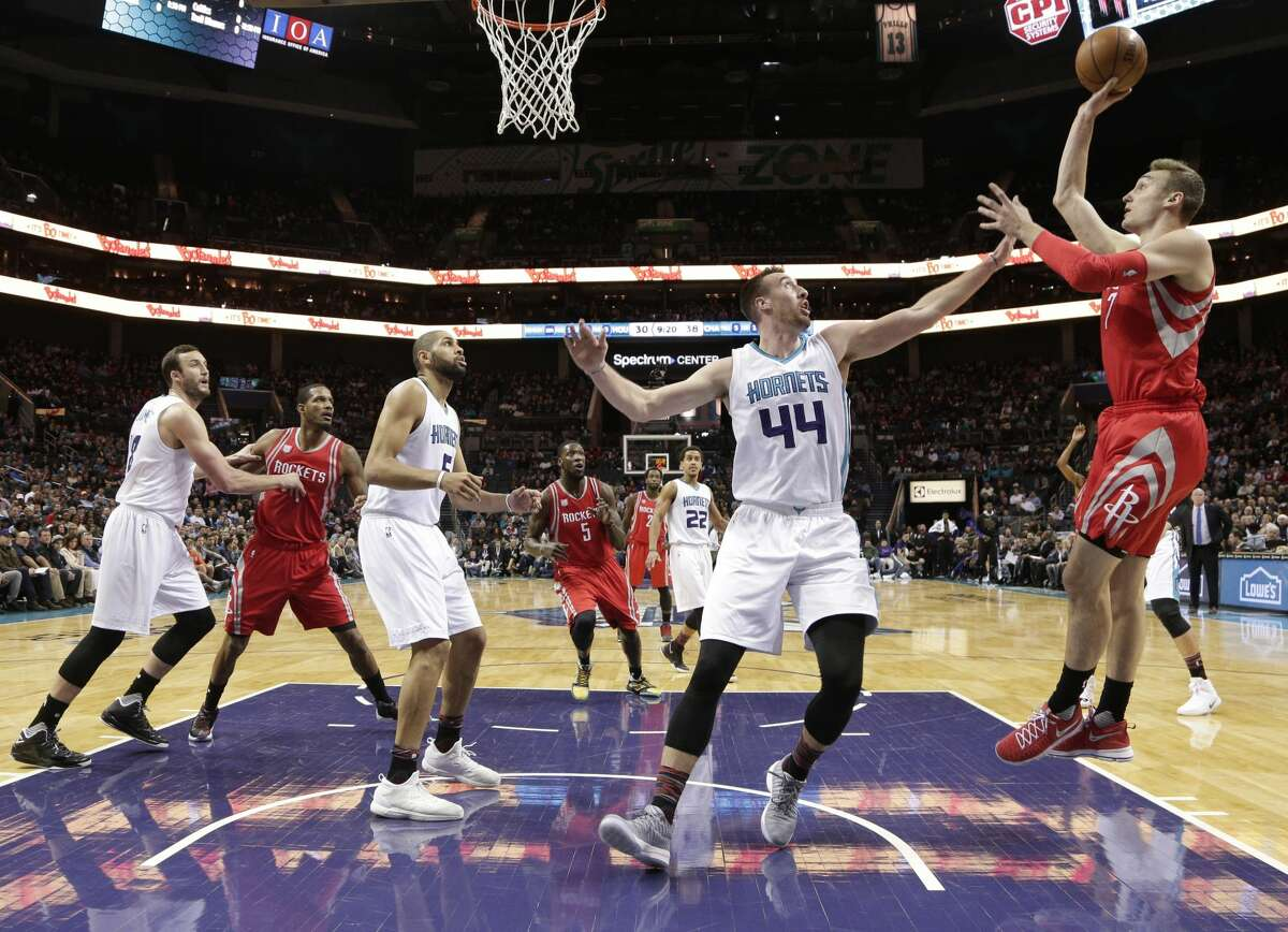 Houston Rockets' Sam Dekker (7) shoots over Charlotte Hornets' Frank Kaminsky III (44) in the first half of an NBA basketball game in Charlotte, N.C., Thursday, Feb. 9, 2017. (AP Photo/Chuck Burton)
