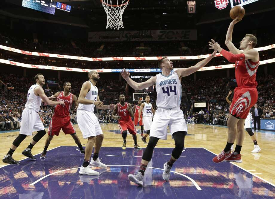 Houston Rockets' Sam Dekker (7) shoots over Charlotte Hornets' Frank Kaminsky III (44) in the first half of an NBA basketball game in Charlotte, N.C., Thursday, Feb. 9, 2017. (AP Photo/Chuck Burton) Photo: Chuck Burton/Associated Press
