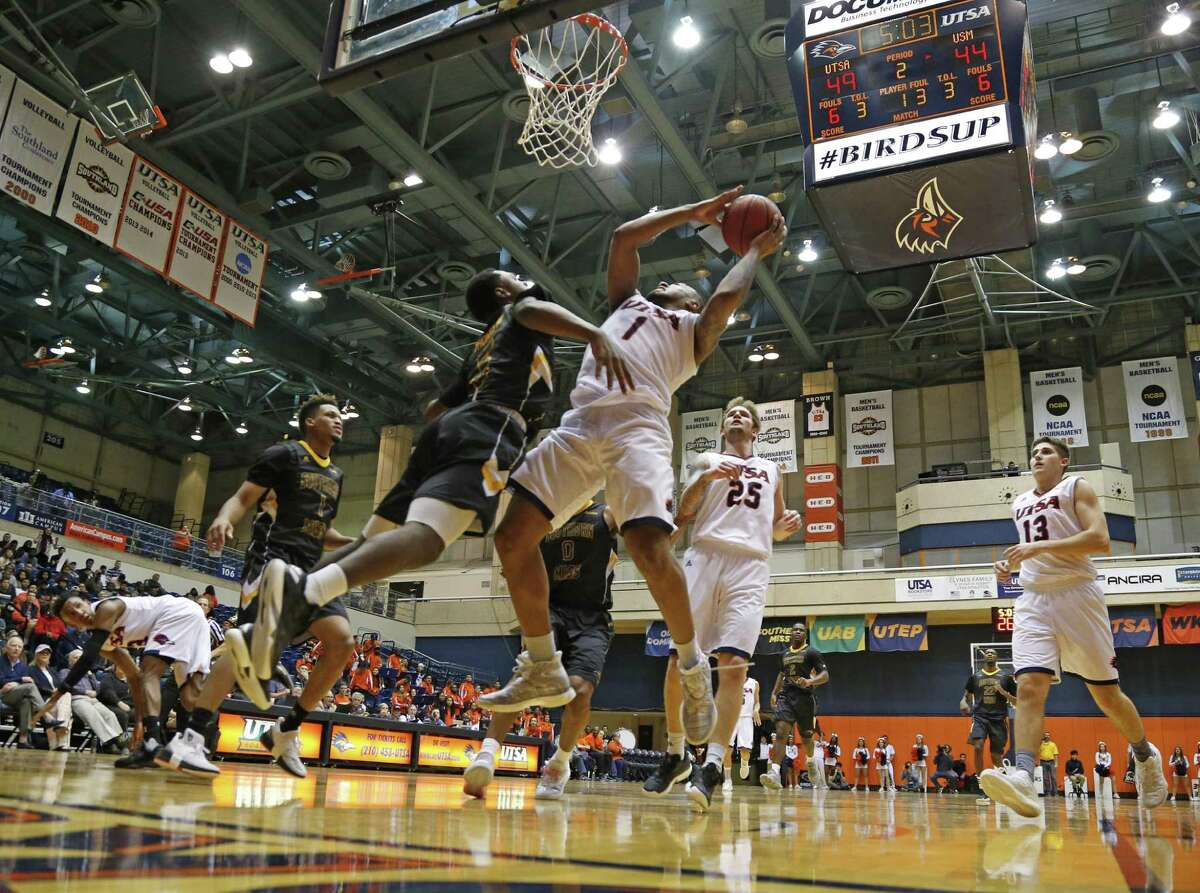 UTSA?•s Jeff Beverly gets an and 1 after being fouled by Southern?•s Mississippi?•s Robert Thomas III on Thursday, January 19, 2017 at Convocation Center.