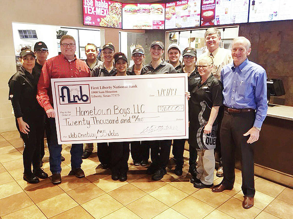 Employees of Hometown Boys, LLC celebrate the opening of their new business and the news they received a $20,000 grant.