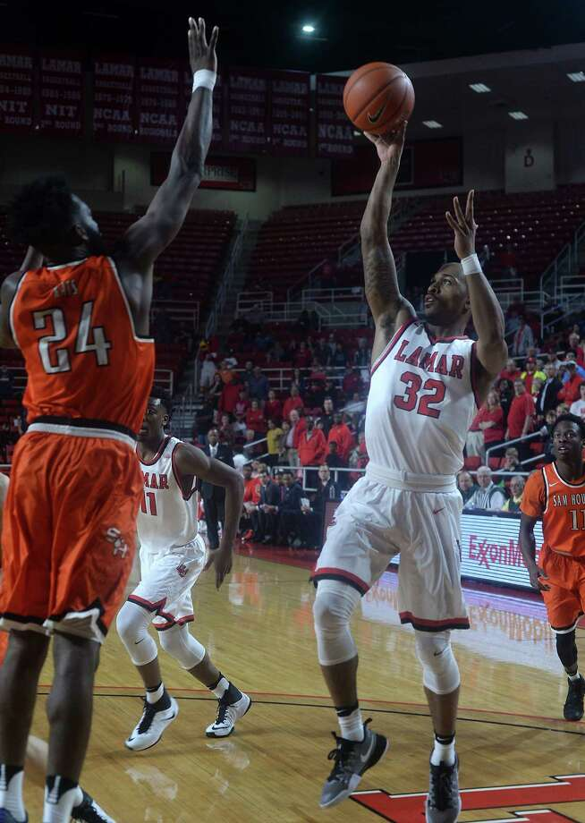 Lamar's Joey Frenchwood puts up his shot as Sam Houston State's Torry Butler looks for the block during Thursday's match-up at the Montagne Center. Photo taken Wednesday, February 9, 2017 Kim Brent/The Enterprise Photo: Kim Brent / Beaumont Enterprise