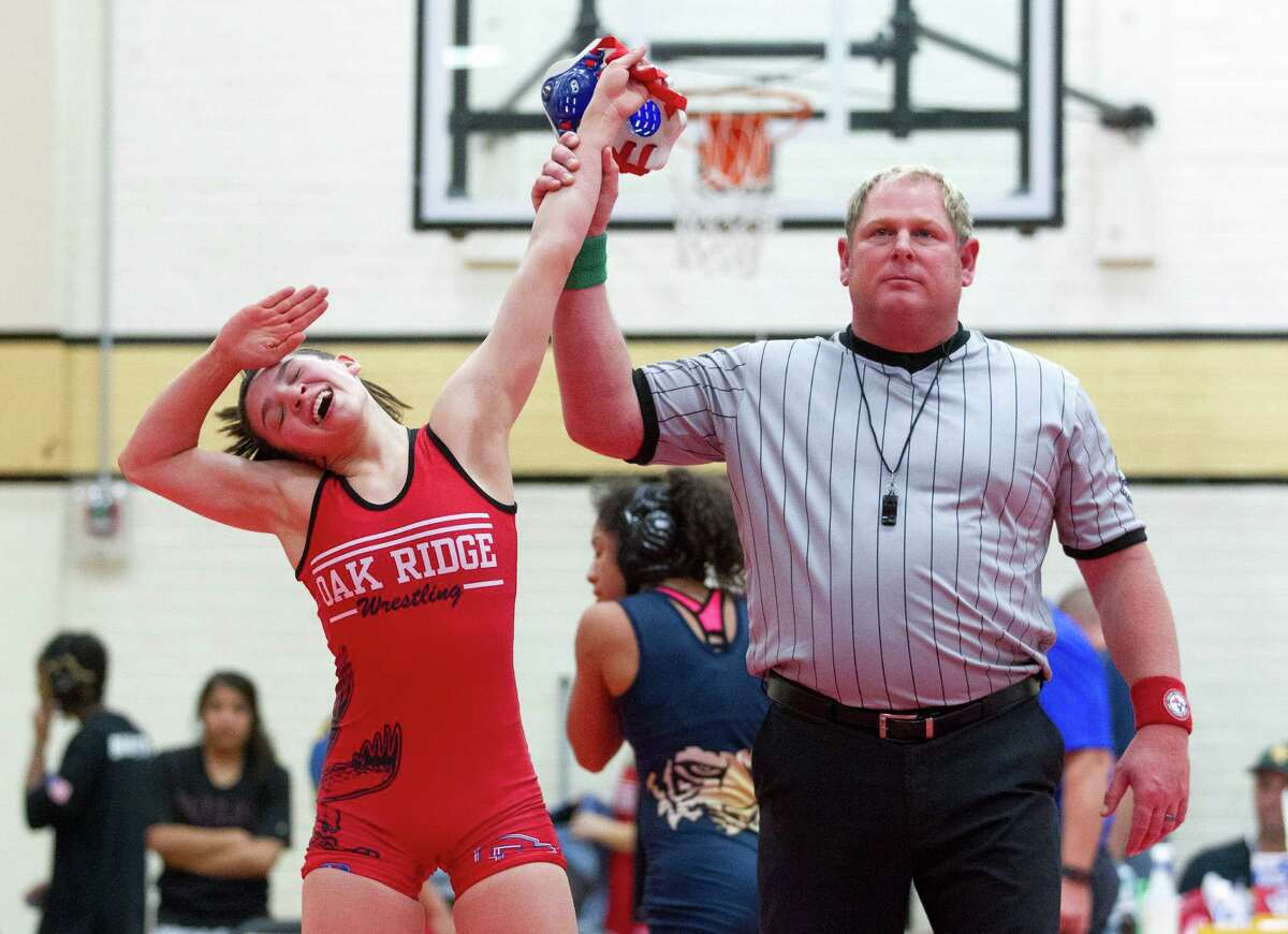 Oak Ridge's Annamarie Crixell celebrates after defeating Klein Collins' Jocelyn Maldonado in the 110 lbs. girls championship round of the District 11-6A wrestling tournament at Conroe High School Thursday, Feb. 9, 2017, in Conroe.