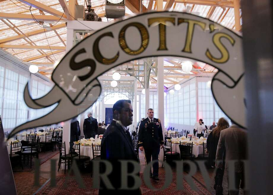 Restaurant personnel prepare the banquet pavilion before a fundraising luncheon for Oakland Military Institute charter school at Scott's Seafood Restaurant in Oakland, Calif., on Thursday, February 9, 2017. The restaurant's owner, Ray Gallagher, has been fined $395,000 by the San Francisco Bay Conservation and Development Commission for having erected the pavilion in which the luncheon was held. Photo: Carlos Avila Gonzalez, The Chronicle