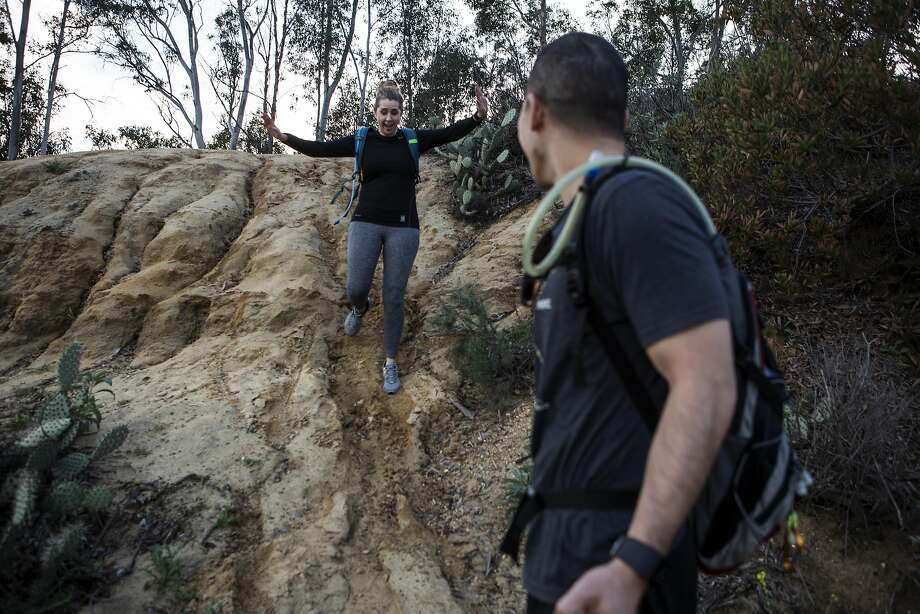 Kevin and Crystal Mo-Wong hike the Fullerton Loop hiking trail on February 9, 2017 in Fullerton, Calif. The couple says their Fitbit's have added a layer to the relationship, encouraging them to work out together and talk about their daily activity. Photo: Dania Maxwell, Special To The Chronicle