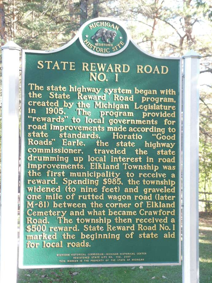 The state did not always help pay for road improvements. The first road to receive state funding is outside of the village of Cass City. There is a green State Historic Marker sign at the intersection of M-81 and Schweigler Road in Elkland Township honoring the first state-funded road and the man who made it happen. Photo: Mary Drier/For The Tribune / Copyright 2012