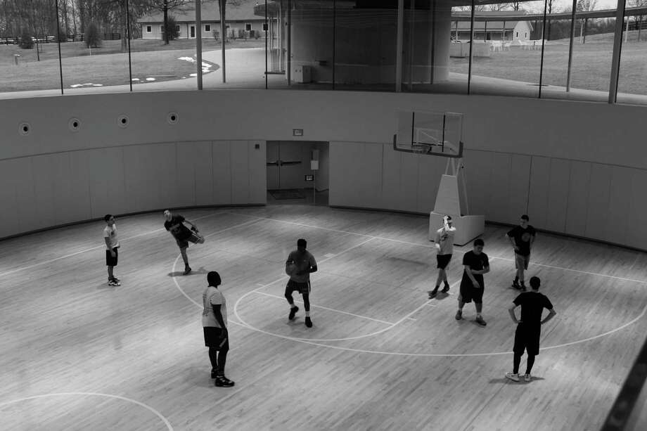 Basketball players take advantage of open gym at the beginning of a pickup game at Grace Farms this week in New Canaan. Photo: Justin Papp / Hearst Connecticut Media / New Canaan News