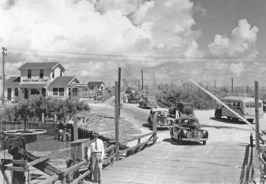 """Then: """"The approach to the Port Aransas ferry landings on Harbor Island looked pretty different 80 years ago. This photo was shot in the 1930s."""" Photo: Courtesy/Port Aransas Museum"""