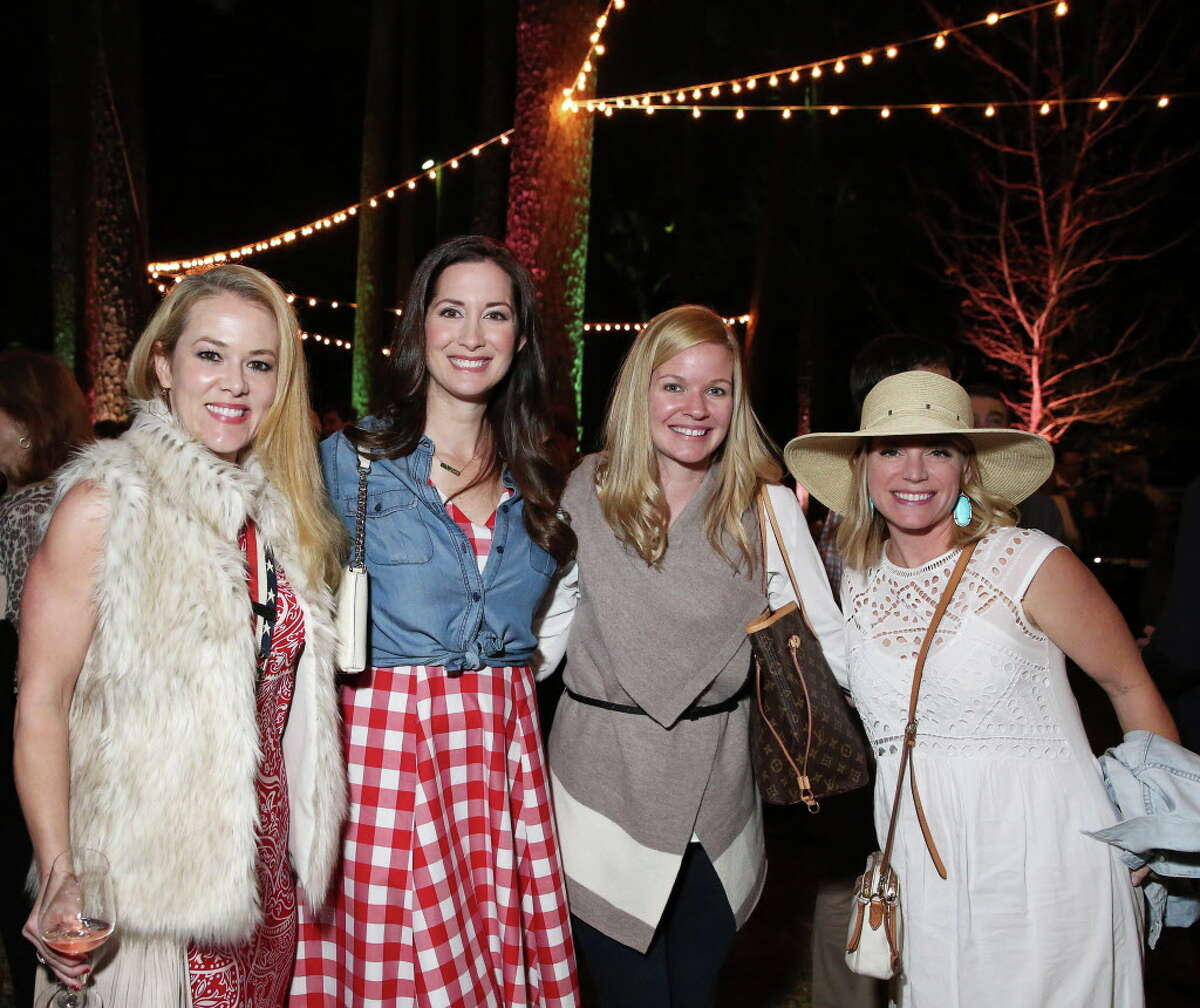 Tania Hovel, from left, Shannon Robinson, Liz Benton and Renee Rice pose for a photo at Memorial Park Conservancy Green Gala at The Forest Club Thursday, Feb. 9, 2017, in Houston.