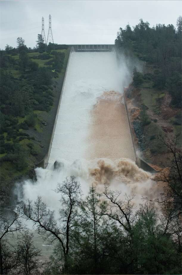 As stormwater poured into the rising Lake Oroville Thursday, the state continued to cautiously continue released down the reservoirs damaged spillway. Photo: DWR