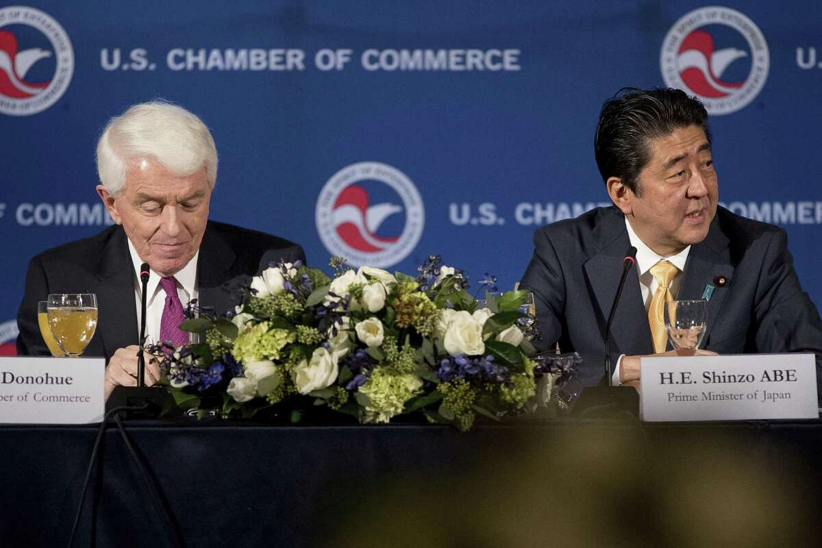 Japanese Prime Minister Shinzo Abe sits next to U.S. Chamber of Commerce CEO and President Tom Donohue as he speaks at a business roundtable Friday at the U.S. Chamber of Commerce in Washington.