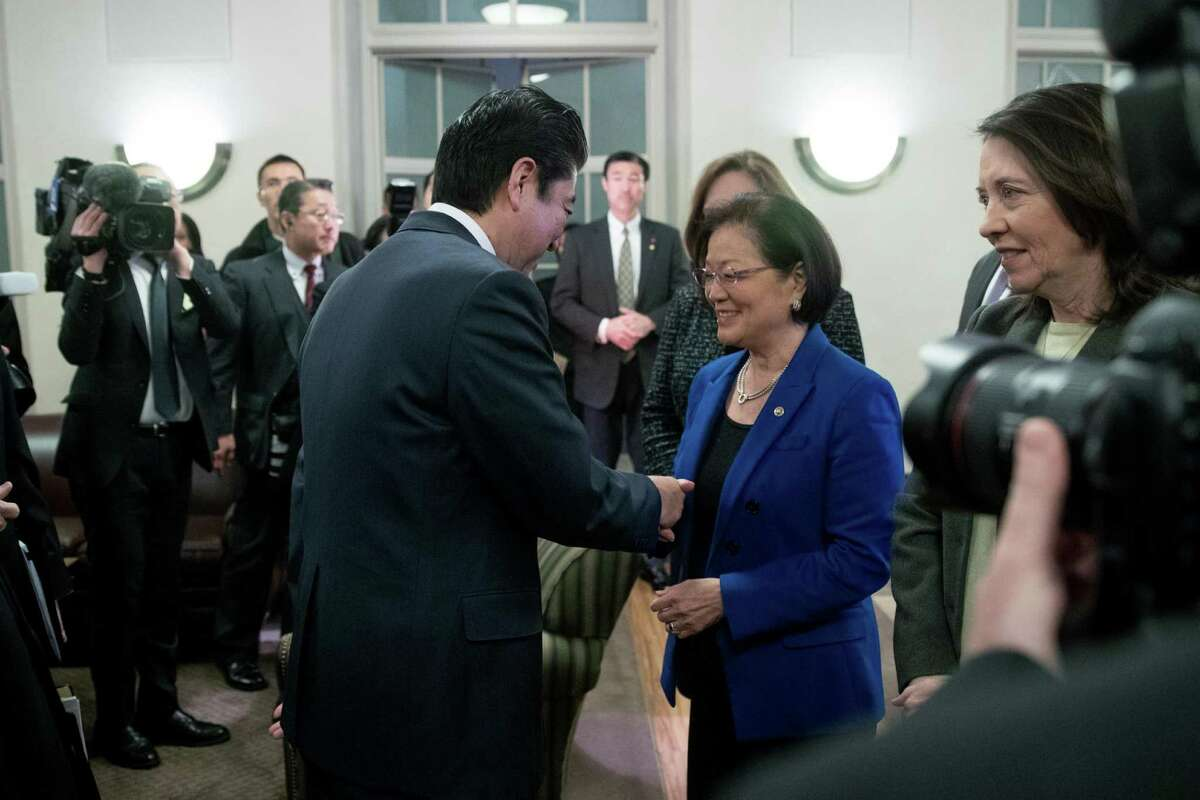 Japanese Prime Minister Shinzo Abe greets Sen. Mazie Hirono, D-Hawaii, at the U.S. Chamber of Commerce on Friday.
