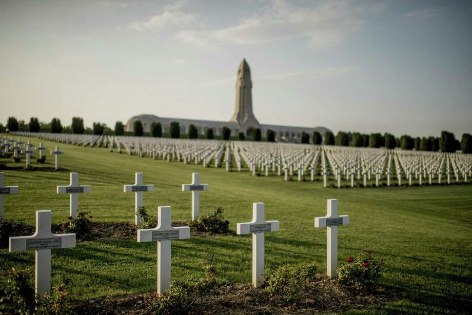 In the distance, the Douaumont Ossuary, where the remains of some 130,000 French and German soldiers are interred, in Verdun, France, June 2, 2014. World War I destroyed kings, kaisers, czars and sultans; it demolished empires; it introduced chemical weapons; it brought millions of women into the work force. (Tomas Munita/The New York Times) Photo: TOMAS MUNITA, STR / NYT / NYTNS