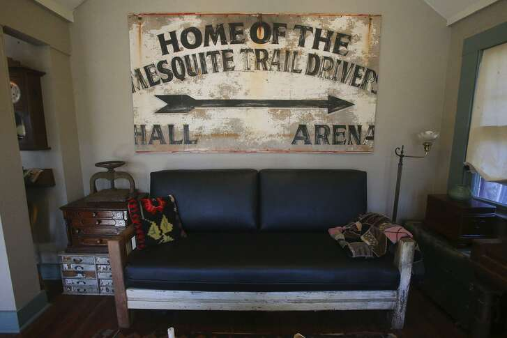In the studio of Katrina Cook's Monticello Park cottage hangs a huge Mesquite Trail Drivers sign from a neighbor's garage that was being cleared. The home will be on the 10th Annual On and Off Fredericksburg Road Studio Tour.