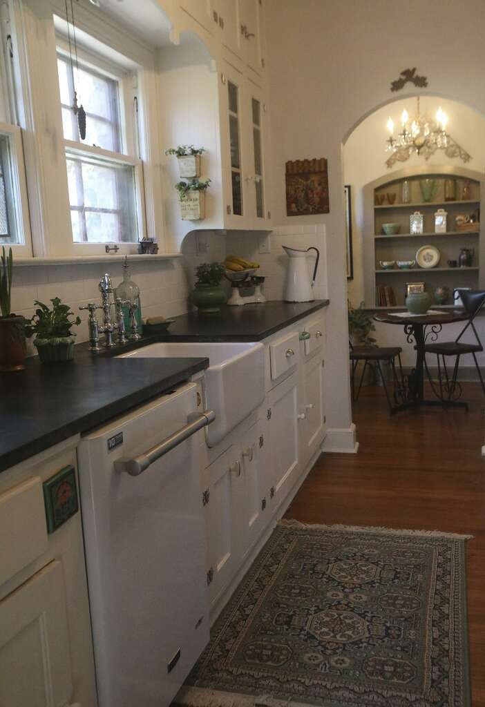 This the kitchen in the Monticello Park home of educator and artist Katrina  Cook  Cook. Annual studio home tour features Woodlawn area English cottage
