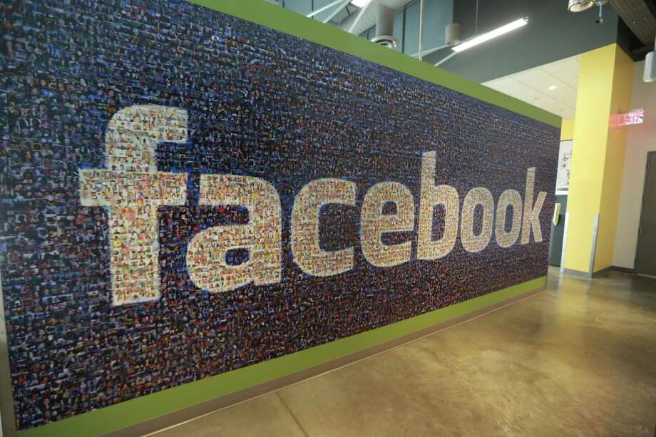 This Friday, Nov. 14, 2014 photo, shows a board with the Facebook logo inside the new Facebook data centers in Altoona, Iowa. Photo: Charlie Litchfield /Associated Press / The Des Moines Register